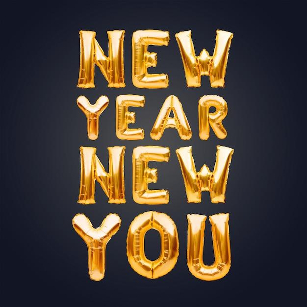 New Year New You Phrase Faite De Ballons Gonflables Dorés Sur Fond Sombre, Nouveau Concept D'objectif. Photo Premium