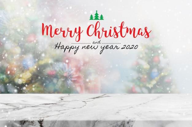 Noël et bonne année 2020 sur une table en marbre vide Photo Premium
