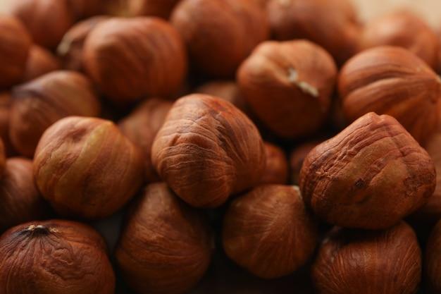 Noisettes Savoureuses Sur Fond Entier, Gros Plan. Nourriture Vitaminée Photo Premium