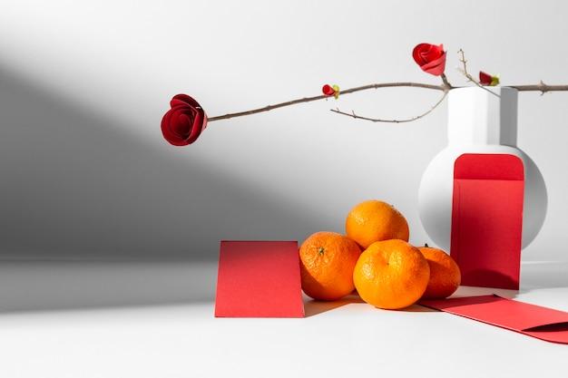 Nouvel An Chinois 2021 Arrangement De Fleurs Et De Fruits Photo gratuit