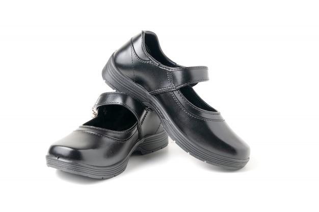 Nouvelles chaussures d'étudiant fille en cuir isolées Photo Premium