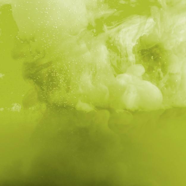 Nuage d'encre vert et jaune Photo gratuit