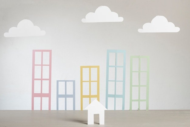 Nuages et bâtiments de la ville de papier abstrait immobilier Photo gratuit
