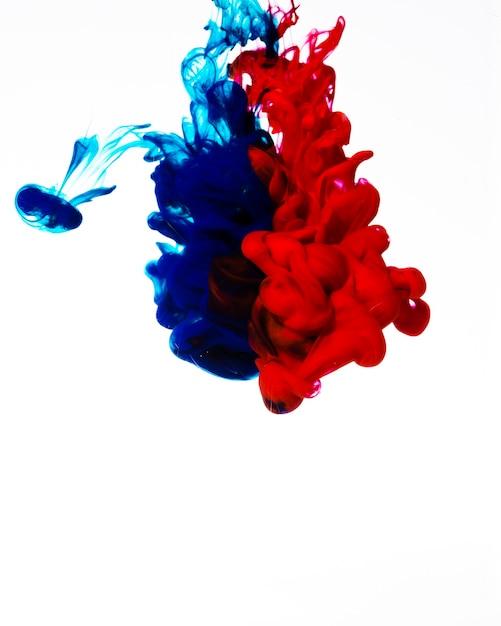 Nuages d'encre vive rouge et bleu Photo gratuit