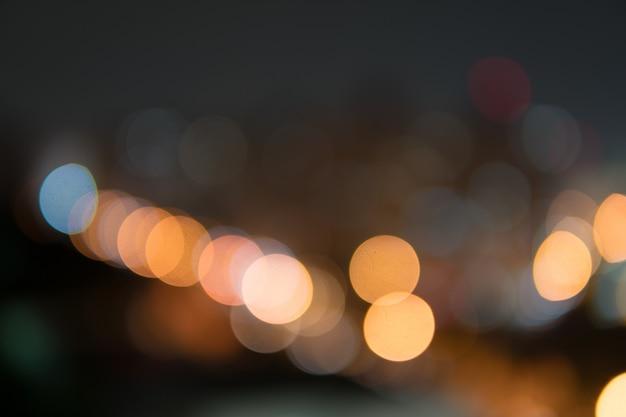 Nuit de la ville défocalisé filtré abstrait bokeh. Photo Premium