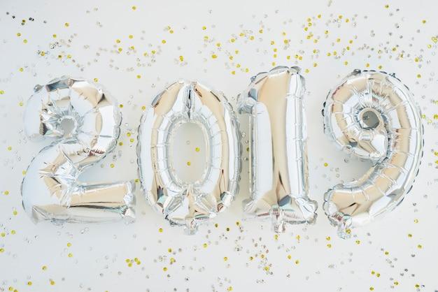 Numéros de ballon de fête du nouvel an Photo gratuit