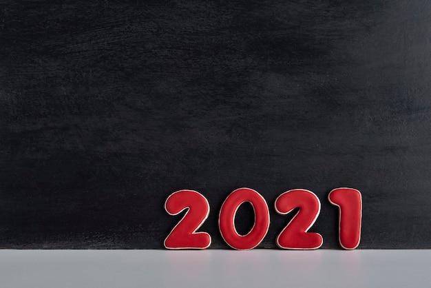 Numéros Rouges 2021 Sur Fond Noir. Copiez L'espace. Photo Premium