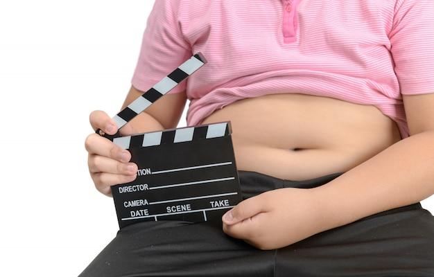 Obèse, gros, garçon, tenue, clapper, planche, film, ardoise Photo Premium