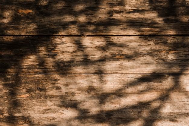 Ombre sur le vieux fond en bois Photo gratuit