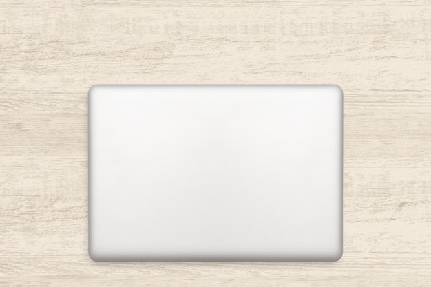 Ordinateur portable sur un fond en bois blanc. Photo Premium