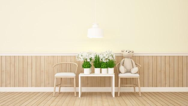 Ours en peluche et fleur dans la chambre jaune Photo Premium