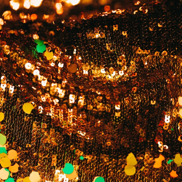 Paillettes brillantes brunes avec des confettis Photo gratuit
