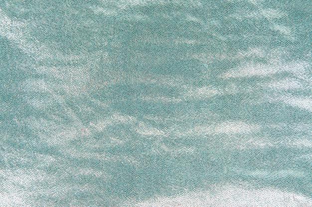 Paillettes brillantes turquoises texturées à l'arrière-plan Photo gratuit