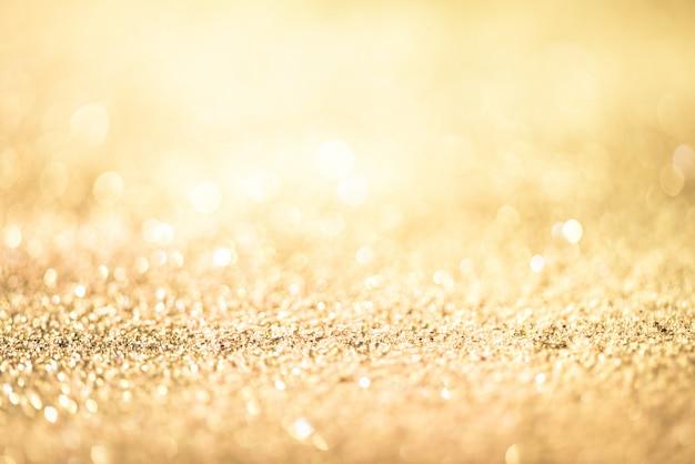 Paillettes d'or bokeh coloré abstrait flou pour anniversaire, anniversaire, mariage Photo Premium