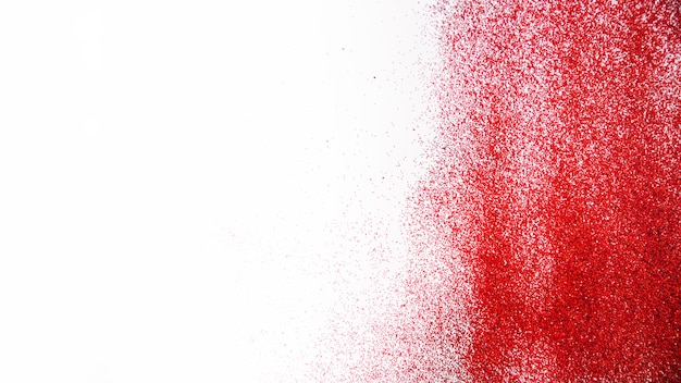 Paillettes rouges sur blanc Photo gratuit