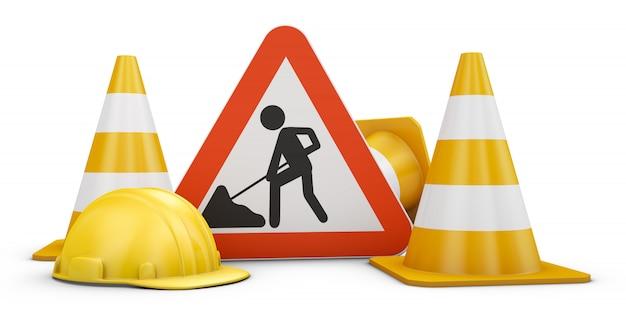 Panneau de signalisation, des cônes et des casques. Photo Premium