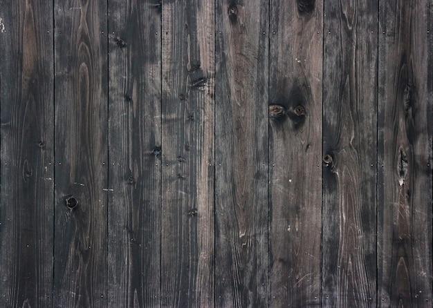 Panneaux de bois foncé âgés fond de mur pour la texture du design vintage. Photo Premium