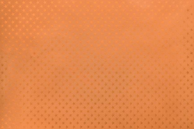 Papier D'aluminium Orange Avec Un Motif D'étoiles Photo Premium