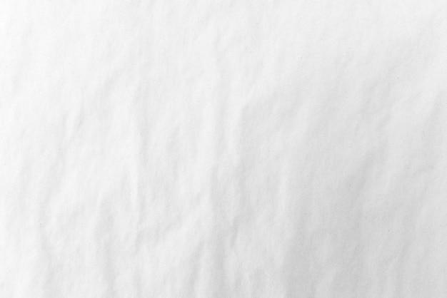 Papier blanc froissé, abstrait fond blanc. lumière claire. Photo Premium