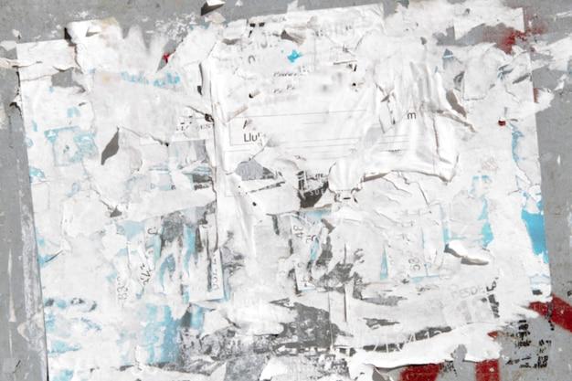 Papier décomposant sur un mur Photo gratuit