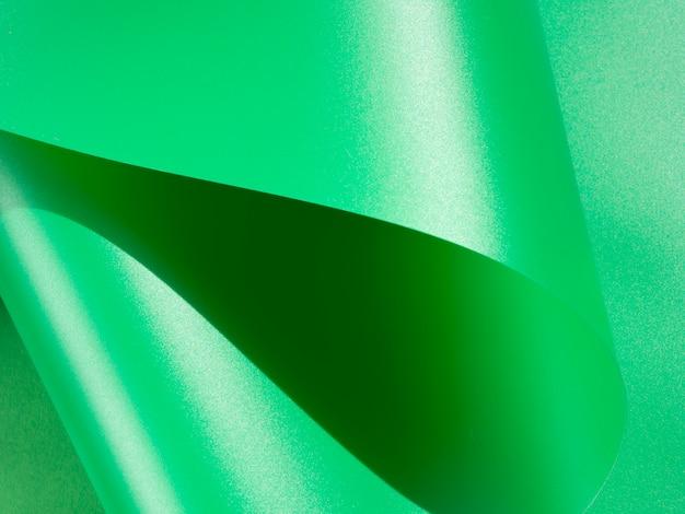 Papier monochrome courbé abstrait vert Photo gratuit