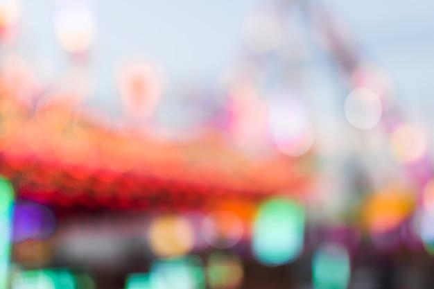 Parc d'attractions avec style flou Photo gratuit