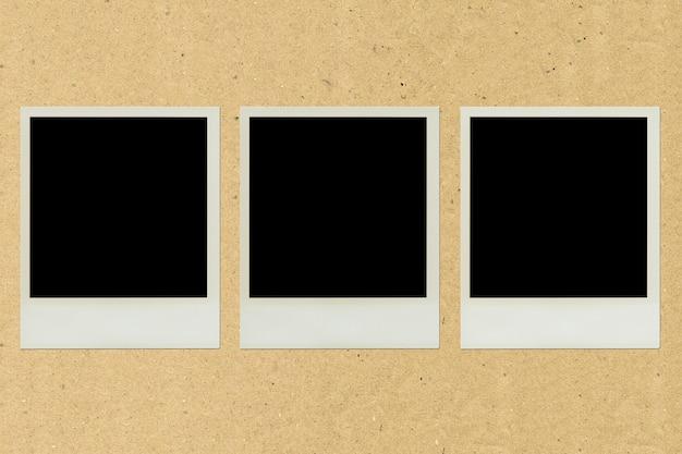 Pâte de cadre photo polaroid sur papier brun Photo Premium