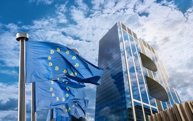 Pavillon Bleu De L'union Européenne Avec Des Icônes Bitcoin Et Un Bâtiment Moderne Sous La Forme D'un Symbole De Photo Premium