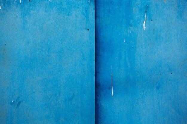 Peint Avec Un Fond Texturé En Métal De Couleur Bleue Photo Premium