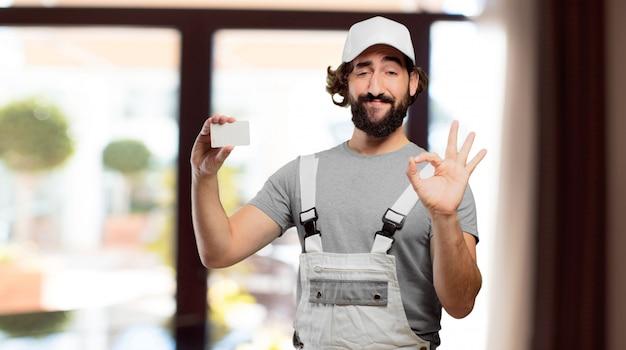 Peintre professionnel tenant une carte de visite Photo Premium