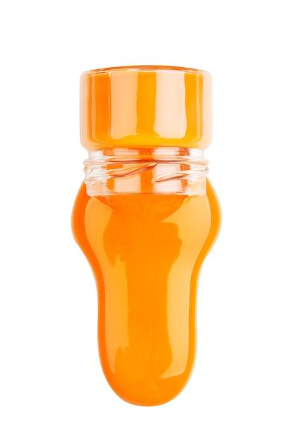 Peinture orange dans un pot isolé Photo Premium