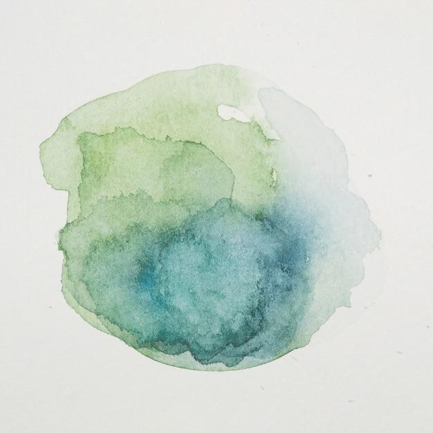Peintures bleues et verdoyantes en forme de cercle sur papier blanc Photo gratuit