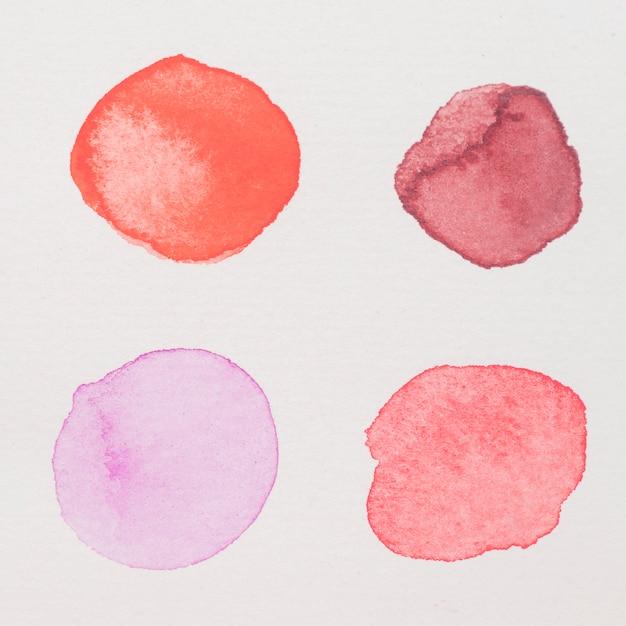 Peintures pourpres, rouges, roses et cramoisies sur papier blanc Photo gratuit