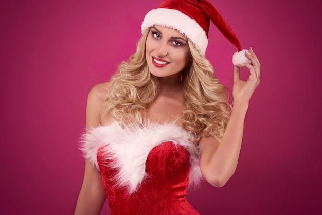 Père Noël Sexy Sur Fond Rose Photo gratuit