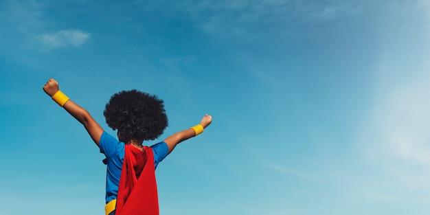 Petit garçon super héros Photo Premium