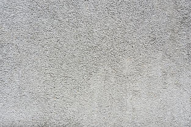 Petit mur de gravier mélanger avec de la pierre grise blanche et noire pour former un mur ou un sol dans le bâtiment. Photo Premium