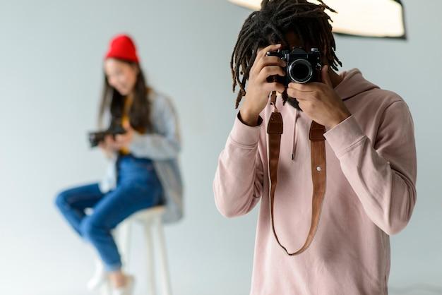 Photographe Prenant Des Photos Photo gratuit