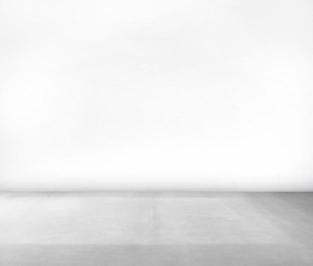 Pièce faite de mur blanc et plancher de béton Photo gratuit