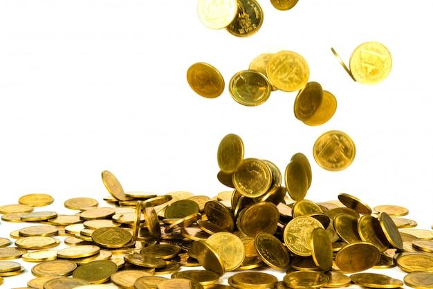 Pièce d'or en baisse isolé sur blanc Photo Premium