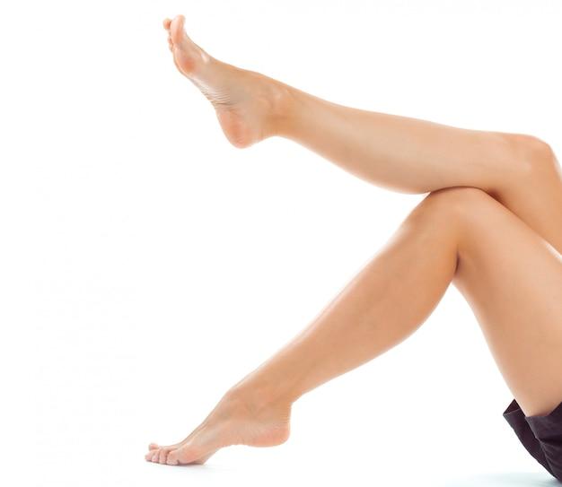 Pieds de belles femmes isolées Photo Premium