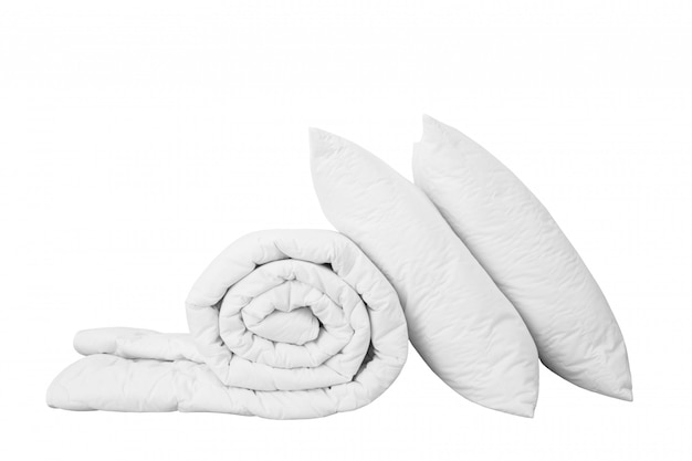 Pile De Literie Sur Le Fond Blanc, Oreiller Blanc Sur La Couette Isolée, Photo Premium