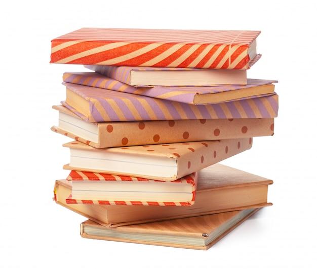Pile de livres isolés sur blanc Photo Premium