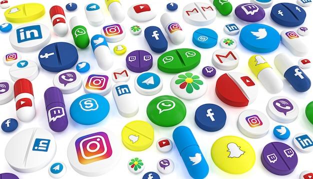 Des pilules de différents types et tailles portant le logo des réseaux sociaux les plus célèbres. Photo Premium