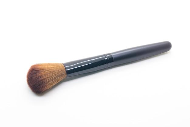 Pinceau de maquillage sur fond blanc Photo Premium