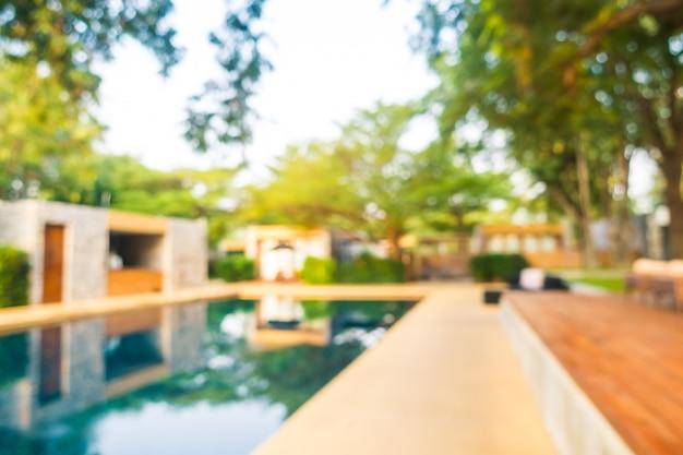 Piscine floue abstraite dans le complexe hôtelier de luxe défocalisé Photo gratuit