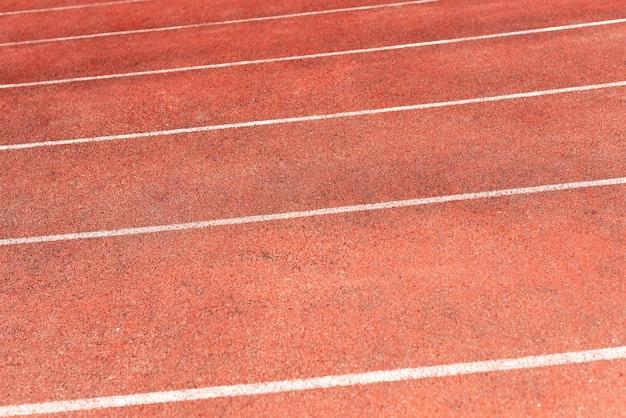 Piste de stade pour les compétitions de course et d'athlétisme. nouveau tapis roulant en caoutchouc synthétique Photo Premium