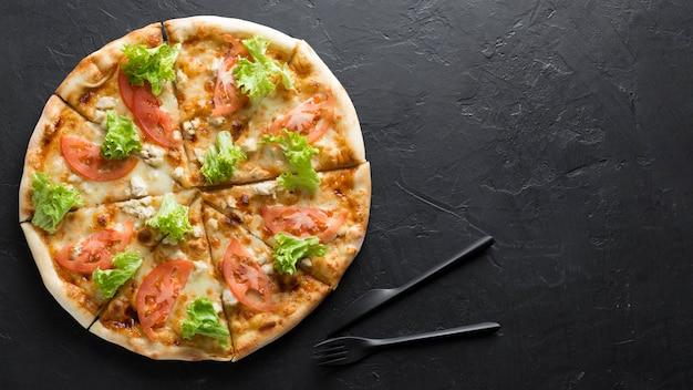 Pizza Vue De Dessus Avec Copie-espace Photo gratuit