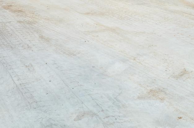 Plancher en béton de surface agrandi avec des traces de pneu fond texturé Photo Premium