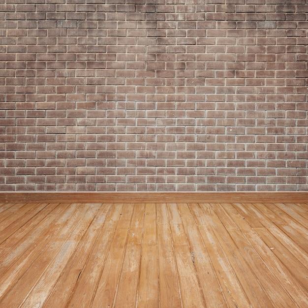 Plancher en bois avec mur de briques Photo gratuit