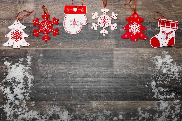 Plancher En Bois Avec La Neige Et La Décoration De Noël Photo gratuit